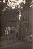 Woman and Dogs in Garden Photographic Print