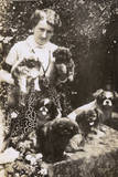 Woman with Pekingese Dogs and Puppies in a Garden Photographic Print