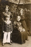 Family of Four with a Dog in a Garden Photographic Print
