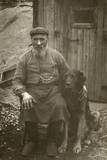 Man in Working Clothes with a Large Dog Photographic Print