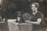 Woman with Two Dogs in a Garden Photographic Print