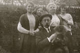 Family Group with Dog in a Garden Photographic Print