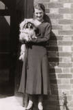 Woman with Pekingese Dog Outside a House Photographic Print
