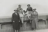 Four Women and a Dog on Holiday Photographic Print