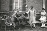 People with Three Dogs in a Garden, France Photographic Print
