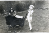 Girl in a Garden with Dog and Doll in Pram Photographic Print