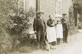 Four People, a Cat and a Dog in a Garden Photographic Print