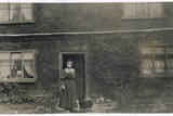 Woman and Dog Outside a Farnhouse Photographic Print