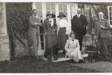 Six People with Two Dogs in a Garden Photographic Print