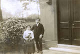 Young Couple and a Puppy in a Garden Photographic Print