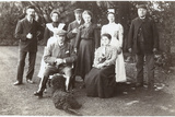 Family Group with Black Poodle in a Garden Photographic Print
