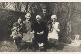 Family Group with Two Dogs in a Garden Photographic Print