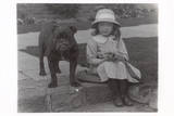 Little Girl and Bulldog in a Garden Photographic Print