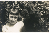 Little Girl with Black Spaniel Dog Photographic Print