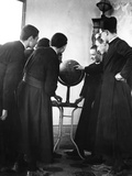 Priests Studying Globe Photographic Print