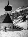 Skiing to Church Photographic Print