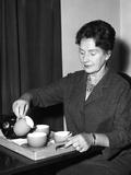 Lady Taking Tea Photographic Print