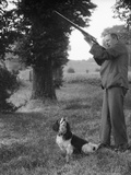 Hunter with Gun and Dog Photographic Print