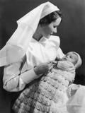 Nurse Holding Baby Photographic Print