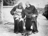 Monks Mending Sandals Photographic Print