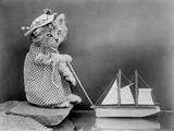 Pussy with a Boat Photographic Print