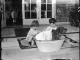 Bathing the Dog Photographic Print