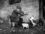 Farmer Feeding Cats Photographic Print
