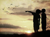 Kids Silhouette Looking at Birds on the Sky in Air Photographic Print by  zurijeta