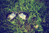 A Pair of Aviators on the Grass Toned with a Retro Vintage Instagram Filter Poster by  graphicphoto