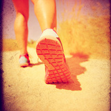 An Athletic Pair of Legs Running or Jogging on a Path during Summer Toned with a Soft Vintage Insta Prints by  graphicphoto