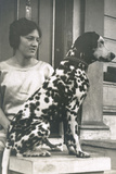 Woman with Dalmatian Outside a House Fotografisk tryk