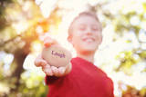 Boy Laughing and Holding a Stone with the Word Laugh. Instagram Effect Photographic Print by  soupstock