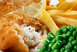 Close up of Fish and Chips with Peas and A Slice of Lemon. Photographic Print by  Stocksolutions