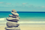 Stack of Balanced Stones in a White Sand Beach, with a Cross-Processed Effect Posters by  nito