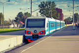 Modern Suburban Electric Train Standing at the Station, Photo with Toned Effect Photographic Print by Eugene Sergeev