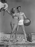 Couple on Beach W/Beach Ball Photographic Print by George Marks