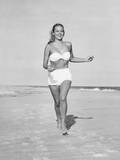 Woman Running on Beach Photographic Print by George Marks