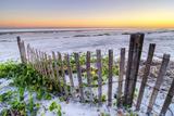A Beach Fence at Sunset on Hilton Head Island, South Carolina. Fotodruck von Rachid Dahnoun