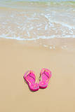 Flip Flops on a Sandy Beach Photographic Print by Kathy Collins