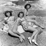 Three Teenage Girls (16-18) Sunbathing on Rocks, Portrait (B&W) Photographic Print by Hulton Archive