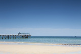 View of a Pier from a Sandy Beach Photographic Print by Caspar Benson
