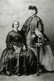 Portrait Group of Two Ladies and Bird Photographic Print by Thomas Fall