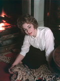 Woman on Rug by Fire Photographic Print by Charles Woof