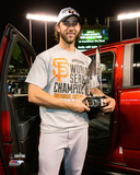 Madison Bumgarner with the MVP Trophy Game 7 of the 2014 World Series Photo