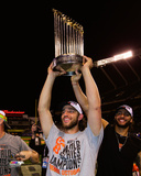 Madison Bumgarner with the World Series Championship Trophy Game 7 of the 2014 World Series Photo