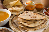 Chapati or Flat Bread, Roti Canai, Indian Food, Made from Wheat Flour Dough. Roti Canai and Curry. Photographic Print by  szefei