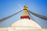Bodhnath Stupa with Buddha Eyes and Prayer Flags, Clear Blue Sky, Kathmandu, Nepal. Stock Photo: Photographic Print by De Visu