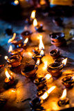 Burning Candles in the Indian Temple during Diwali, The Festival of Lights Photographic Print by Andrey Armyagov
