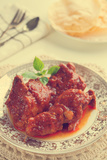 Indian Curry Chicken. Popular Indian Dish on Dining Table in Retro Vintage Style. Photographic Print by  szefei