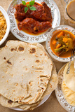 Chapatti Roti, Curry Chicken, Biryani Rice, Salad, Masala Milk Tea and Papadom. Indian Food on Dini Photographic Print by  szefei